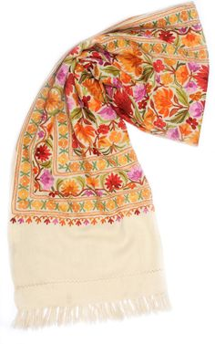 ARI JAMAVAR. You have to believe us when we say that the Jamavar work on this shawl has to be seen to be believed! The rainbow of colors–yellow, orange, mauve, pink, green–come together to enhance your ensemble beyond compare! The white base contrasts perfectly to bring each color and detail to life.