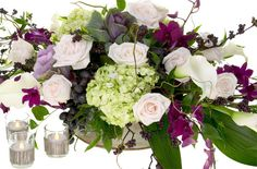 Love the purple & green   As well as the grapes worked in w/curly willow