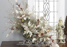 Christmas Floral Arrangement in sleigh. Winter Floral Arrangements, Christmas Arrangements, Christmas Centerpieces, Xmas Decorations, Flower Arrangements, Christmas Tables, Christmas Swags, Christmas Flowers, White Christmas