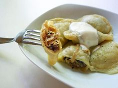Cooking Weekends: Pierogi with Sauerkraut, Mushroom & Bacon Filling - Want to make sauerkraut pierogis soon, maybe I'll use this recipe.
