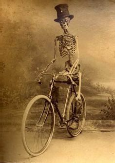 Skeleton, bike, natty hat, via Weird Vintage