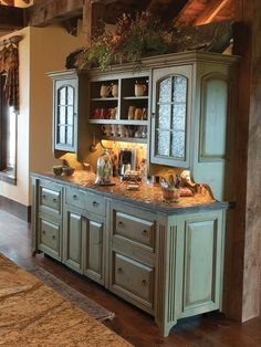 RUSTIC KITCHEN love this green buffet cabinet for in the kitchen to compliment my green dishes. nice transition.