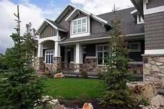 Lane Myers Construction Custom Home Builder Field of Dreams White Trim Brown Paneling Stone Exterior
