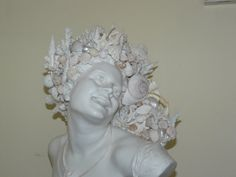 Hey, I found this really awesome Etsy listing at https://www.etsy.com/listing/195457915/beautiful-seashell-adorned-statue