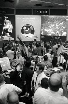 "Mission Control celebrating the successful conclusion of the Apollo 11 mission on July 24, 1969 On July 20, Neil Armstrong was the first human to step onto another world. He was followed shortly by Buzz Aldrin. (Image Credit: NASA) Ian Ridpath, ""Exploring the Apollo Landing Sites"", http://www.bellaonline.com/articles/art29536.asp"