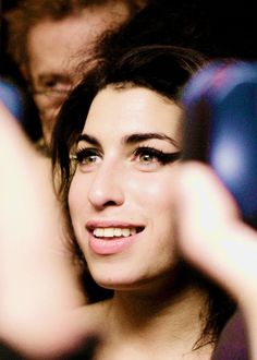 """Amy Winehouse was born in north London, to Jewish parents. Her father, Mitchell """"Mitch"""" Winehouse, was a window panel installer then a taxi driver; her mother, Janis Winehouse (née Seaton), a pharmacist. The Winehouse ancestors were Russian and Polish immigrants to London. Amy had an older brother, Alex (born 1979)."""