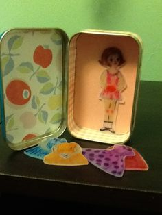 Repurposed Altoid tin by Catherine Kanvik. Shrinky Dink paper doll.