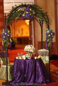 b94fab577238 purple flowers in wedding arch Blue Wedding Receptions