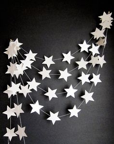 Scandi Nordic Christmas garland / star garland / baby shower / nursery decor Simple white card star garland is light enough to be hung on almost any surface, including the mantelpiece / chimney bre. Noel Christmas, Christmas Crafts, Christmas Garlands, Xmas, Christmas Decorations For Classroom, Cheap Christmas, Origami Christmas, White Christmas, Vintage Christmas