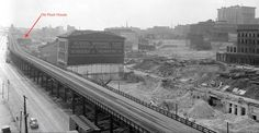 While the riverfront clearance progressed in the early '40s, the Old Rock House remained, with its mansard roof, chimneys, and dormers, visible on the left in this photo taken from Eads Bridge.