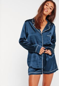 This silky set will keep you looking fierce, even in your sleep! In a navy hue, contrasting piping and button down shirt - this is our new fave pj set!