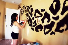 Leopard Print Wall. this is def something I would consider in a craft room or something. =)