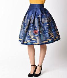 Its put a spell on you, gals! The new Lindy Bop skirt is a ready for a stroll on Park Avenue with the chaotic scenes of weaving yellow taxis, skyscrapers, and bright signs set against an elegant navy blue night sky. Crafted in a glossy poly satin with a