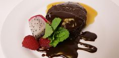 Flourless Chocolate Cake served with Warm Liqueur Chocolate Sauce and Caramel Come Dine With Me, Flourless Chocolate Cakes, Yummy Food, Tasty, Cake Servings, Food Network Recipes, Caramel, Food And Drink, Favorite Recipes
