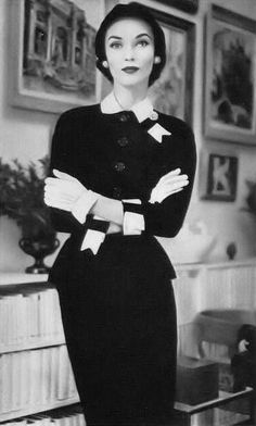 Janet Randy, Vogue October 1951 Me: I chose this pin to portray an example of women's suits in the 1950s while simultaneously providing a little insight to the home.