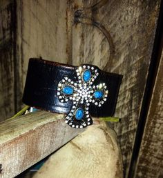 Vintage black leather cuff with turquoise and rhinestone cross concho on Etsy, $40.00