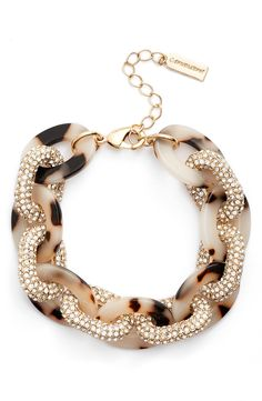 Oversized links of light tortoiseshell and pavé-set crystals shape this statement-making bracelet with chic, of-the-moment style.