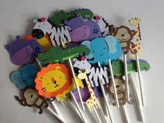 Set Of 24 Safari/Jungle Animal Cupcake Toppers great for Baby Showers,Birthday Parties ,zebra, elephant, alligator, monkey, hippo, lion, zoo. $20.00, via Etsy.