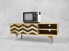 Mid century design mixed with modern contemporary finished produces this unique one of a kind TV cabinet.