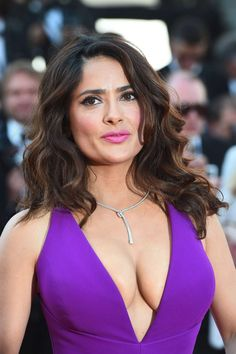 Salma Hayek voluptuous in a low cut purple dress at Cannes ~ Celebrity Plunge