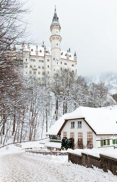 Neuschwanstein Castle in Germany during a snowy winter.