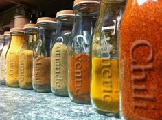 Spices in Frappicino Bottles. I think I'd spray the caps in blackboard paint