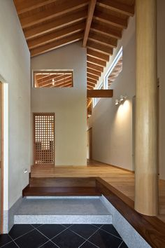 Timber-framed house designed to frame five separate gardens and terraces. [entrance step up]