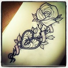 Heart locket, rose Tattoo. Owen's name and birthdate on the ribbon