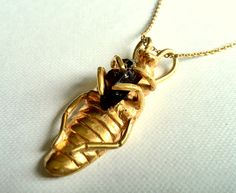 Cockroach Pendant. smoky quartz, bronze, gold plate. Georgina Taylor