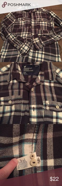 Men's Small American Eagle Flannel Men's Size Small. American Eagle Flannel. EUC. Gray, White, & Blue Flannel. 100% Cotton. Extra buttons sewn in tag. No rips or stains. Smoke free home. American Eagle Outfitters Shirts Casual Button Down Shirts