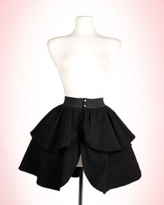 Black Canvas Underskirt. Short canvas underskirt to add fullness without the bulk of a petticoat. Pin-Up Girl Clothing