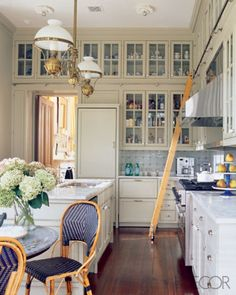 Katie Ridder's amazing kitchen.  double height glass front cabinets and I love a library ladder