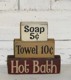 These primitive wood shelf sitters will make a nice addition to any country / primitive bathroom. I have painted this set with black underneath the topcoat. I have added a topcoat combination of ivory, spice tan and burgundy and then distressed each block before the lettering. You will have your choice of colors.  Measures approx. 8 x 8 wide.