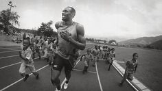 Usain Bolt running with children - how excited are they?  Very!