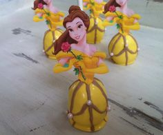 Belle Pops of Beauty and the Beast    The Belle of the ball. The first of our Disney Princess Pop Collection, Belle is artistically  created to be a wonderful addition to your special event or birthday party. Made from scratch  with my secret recipe, dipped in creamy chocolate and beautifully created for any Disney  lover.