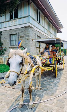 One of the experiences you shouldn't miss when traveling to The Philippines -- Kalesa Ride! Check blog post to see where you can try this.