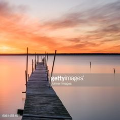 Stock Photo : Wooden pier and lake at sunset