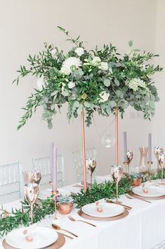 Modern floral centerpiece on copper stand as an installation over the table by Luke and Lottie Floral Design | Wedding Tablescape Inspirations Mixing Modern with the Traditional - BLOVED Blog