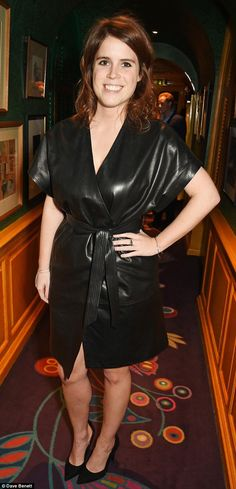 Eugenie went bare-legged with her leather kimono-style dress and kept her accessories to a...