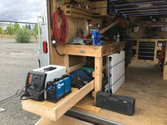 Enclosed job site trailer. Slide out for plasma cutter and welder