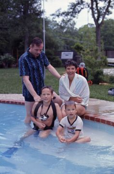 """Ralph Morse—Time & Life Pictures/Getty Images  Unpublished. Neil Armstrong, his wife Jan, and their two sons, Ricky (left) and Mark, at home in Texas, March 1969. """"Right away, the kids got used to me being around. You know how kids are; they adapt to things really well. After a while, spending so much time with them, it wasn't awkward or forced having me around. I was the guy who was always there, with the camera."""""""
