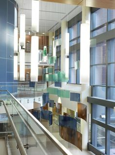 Inspired by Buck Creek, which runs beside Springfield Regional Medical Center, this fabricated piece brings the outdoors in as a focal point in the facility's atrium lobby. The piece is suspended from the ceiling with a custom-engineered cable system. Photo credit: Alise OBrien.