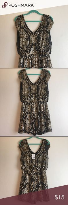 NWT Romper Fancy Sequined Black and Gold Fancy sequined black and gold romper. NWT. Never worn. Black lining. Split flutter sleeves. ❤️❤️❤️ by HS Pants Jumpsuits & Rompers