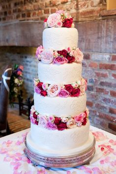 Wedding cake with fresh flowers....would love it more if them white was just smooth fondant