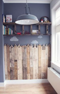 Super cure wooden fence wall for play room. mommo design: LADDER LOVE love the ladder shelf but even more so love the pallet city scape. would be great behind boys beds for superhero room