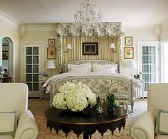 Anchored by an elaborately outfitted Louis XVI canopy bed from Louis J. Solomon, this master bedroom basks in a dreamy, glowing palette of cream and blue.