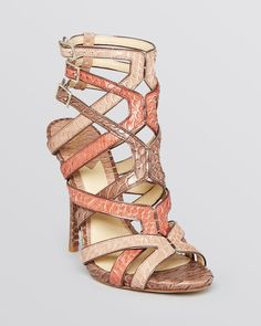 """Open toe; contrasting snakeskin straps with metallic leather trim; buckled ankle straps 4.25"""" heel, .25"""" platform, feels like 4"""" heel Available in full and half sizes Water Snake upper, Water Snake an"""