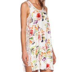 mink pink flower cover up dress It is a floral print cover up for swimming or can be worn as a dress. It has a lace layer underneath as well. It is reversible so you can have the floral print on the outside or the lace layer. MINKPINK Swim Coverups