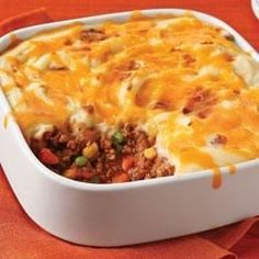 An easy shepherd's pie made with lean ground beef has a light but flavorful layer of creamy mashed potatoes on top.