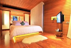 Google Image Result for http://cdn.home-designing.com/wp-content/uploads/2012/04/Wood-clad-walls-modern-bedroom-design.jpeg